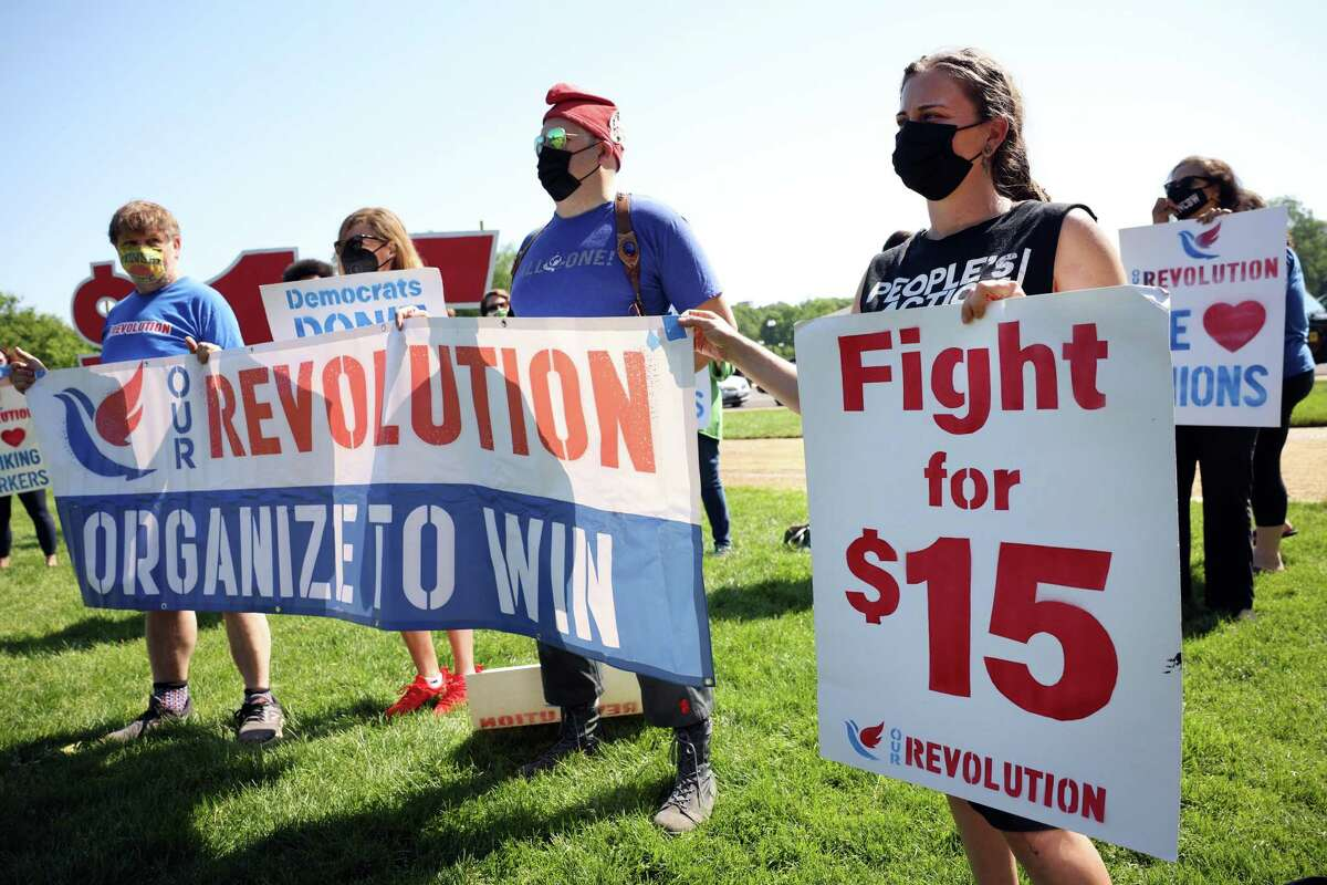 Labor activists rally in Washington, D.C. on May 19, 2021, in support of a $15 minimum wage law.