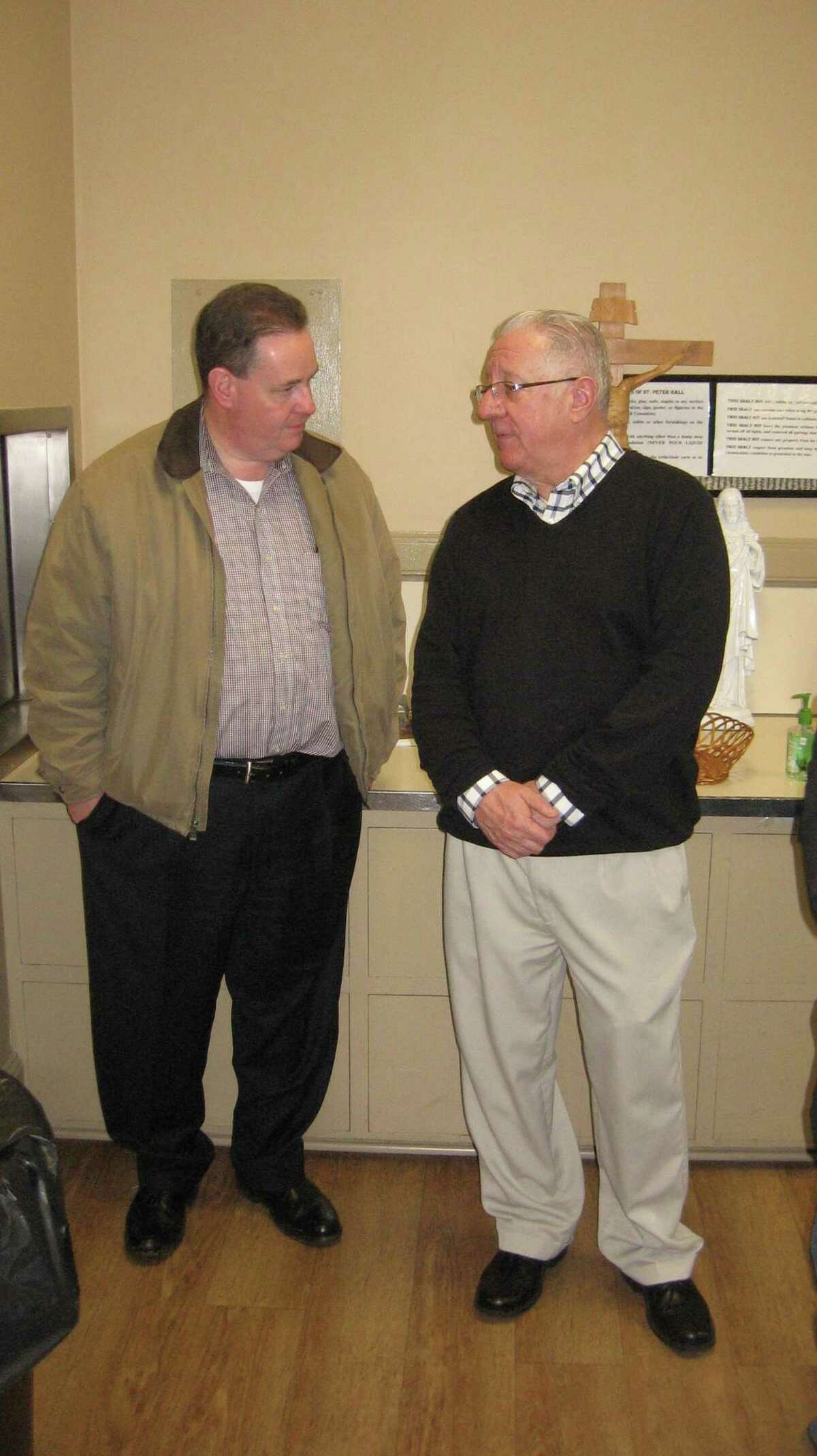 United Way of Northwest Connecticut Executive Director Owen Quinn, right, talks with FISH board member Christopher Ryan during an event in 2019.