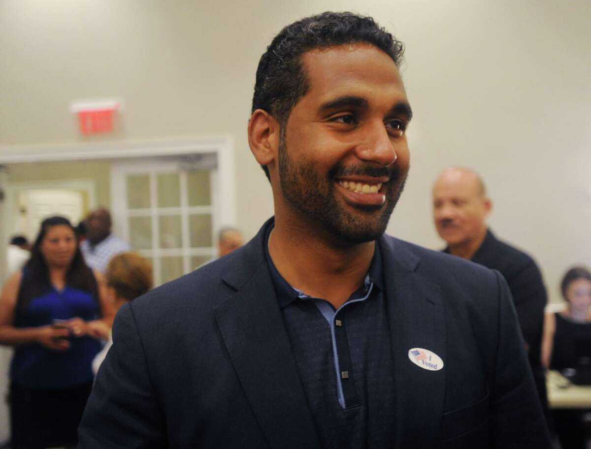 Dennis Bradley is all smiles after winning his race for the 23rd District State Senate seat at Testo's Restaurant in Bridgeport, Conn on Tuesday, August 14, 2018.