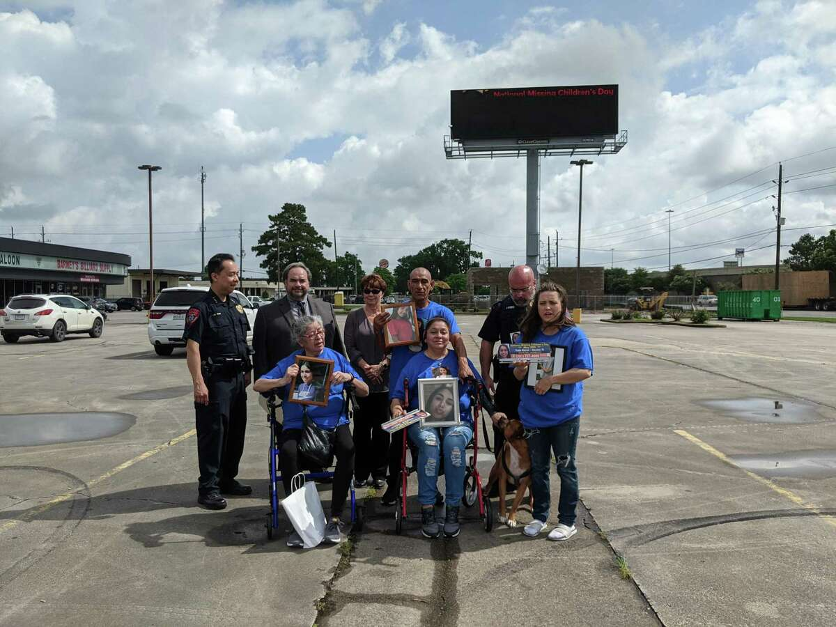 A digital billboard featuring missing Katy teen Thalia Macias was unveiled on Tuesday. Shown here are Henry Gaw, Chief of Police, Katy ISD; Lee Vela, VP Public Affairs, Clear Channel Outdoor; Beth Alberts, CEO of Texas Center for the Missing; Ana Escobedo, Thalia's Aunt; Alma Romero, Thalia's mother; Hose Romero, Thalia's father; Frank Muniz, Detective and Training Officer, Katy ISD; and Jayni Dutton, Thalia's neighbor. The dog is Simba, who was a puppy when Thalia last played with him.