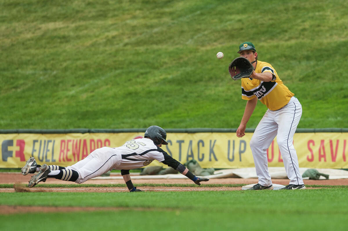 Dow's Bill VanSumeren catches the ball in an attempt to tag out Bullock Creek's Nathan Masar during their game Tuesday, May 25, 2021 at Dow Diamond in Midland. (Katy Kildee/kkildee@mdn.net)