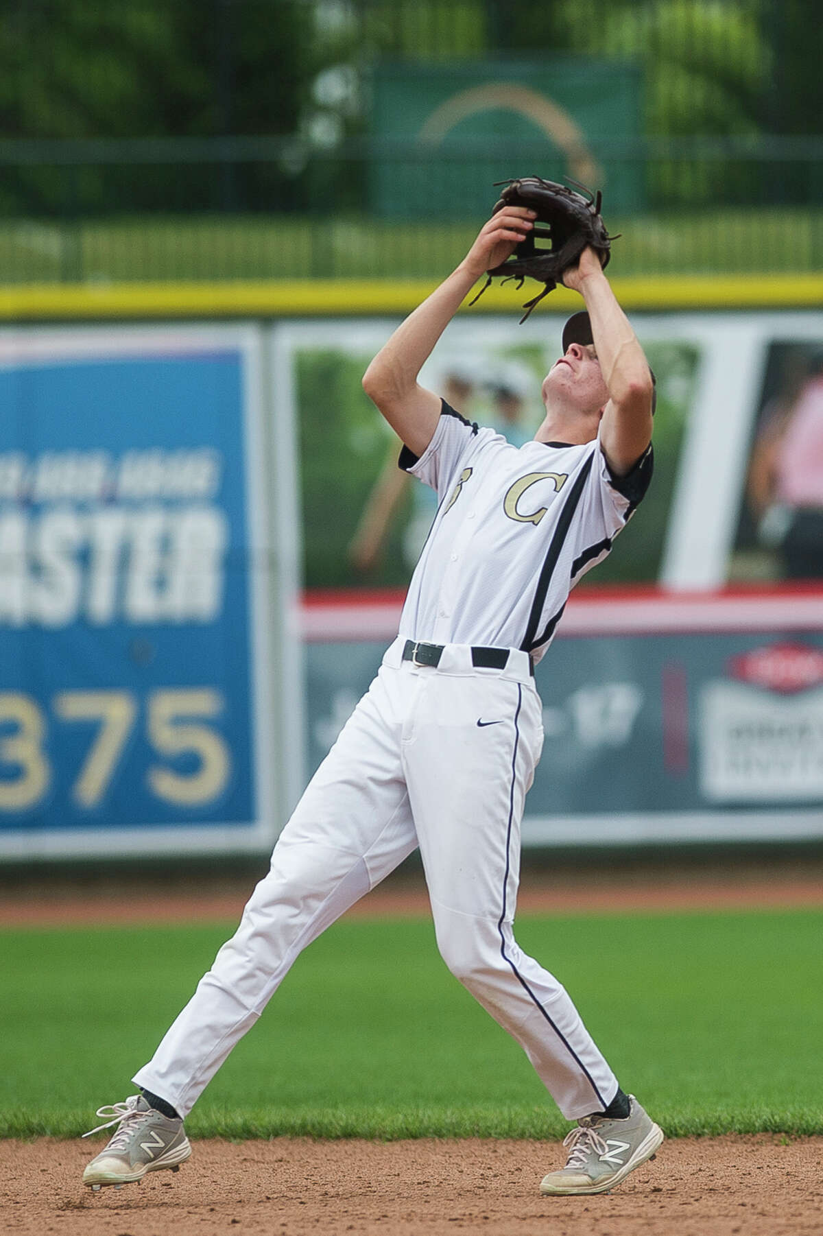 Bullock Creek's Jacob Claus catches a pop-up during a game against Dow Tuesday, May 25, 2021 at Dow Diamond in Midland. (Katy Kildee/kkildee@mdn.net)