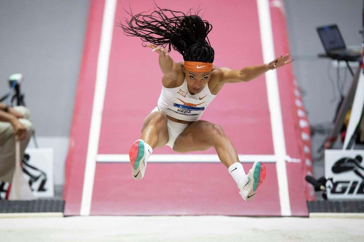 Texas' Tara Davis soars to an NCAA indoor long jump title in March in Fayetteville, Ark.