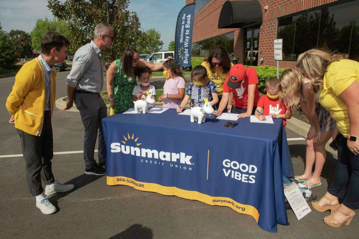Beekman 1802 Co-Founders Dr. Brent Ridge, left, and Josh Kilmer-Purcell, second from left, join Sunmark credt union as they unveil their 'Summer of Kindness' effort at Sunmark headquarters on Tuesday, May 25, 2021 in Latham, N.Y. The kids were filling out forms on how they would spread kindness to their community. (Lori Van Buren/Times Union)