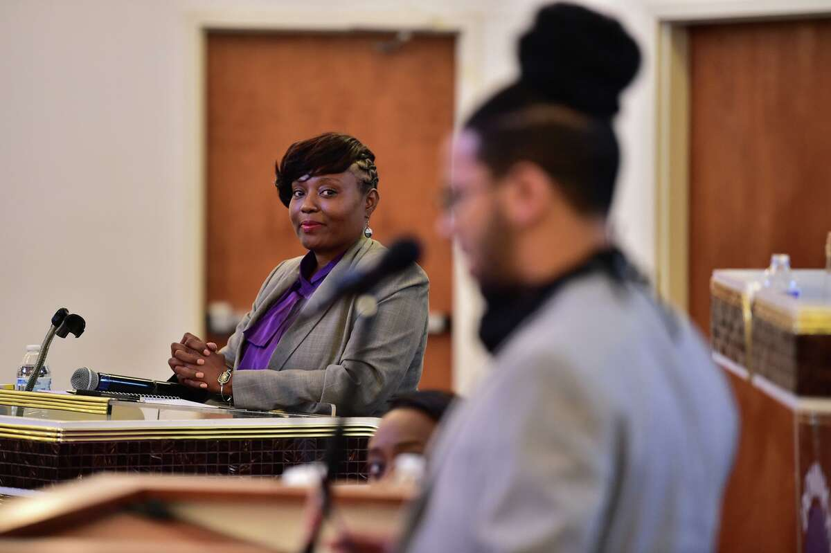 FILE PHOTO - Incumbent Jada Andrews-Sullivan glances over at challenger Jalen McKee-Rodriguez during a District 2 City Council debate at Dominion Church of God in Christ.