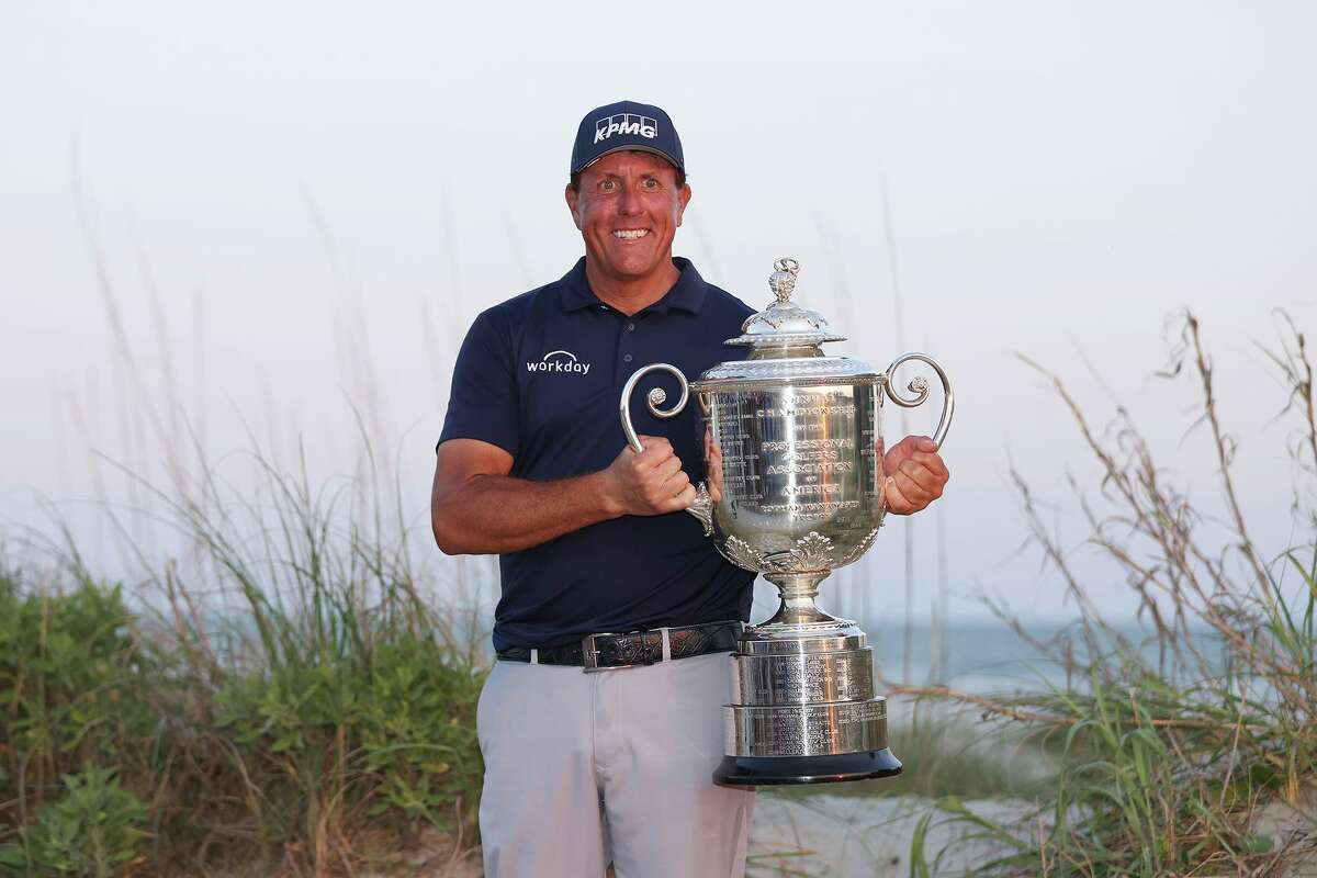 Phil Mickelson of the United States celebrates with the Wanamaker Trophy after winning during the final round of the 2021 PGA Championship held at the Ocean Course of Kiawah Island Golf Resort on May 23, 2021 in Kiawah Island, South Carolina. (Gregory Shamus/Getty Images/TNS)
