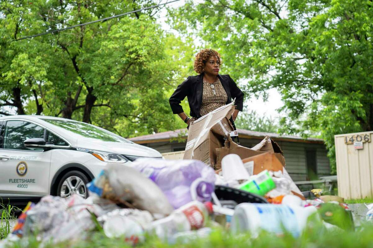 Councilmember Tarsha Jackson, who represents District B, looks at an illegal dumping site in Fifth Ward that she and her staff have been working to have cleaned up, Tuesday, May 25, 2021, in Houston.