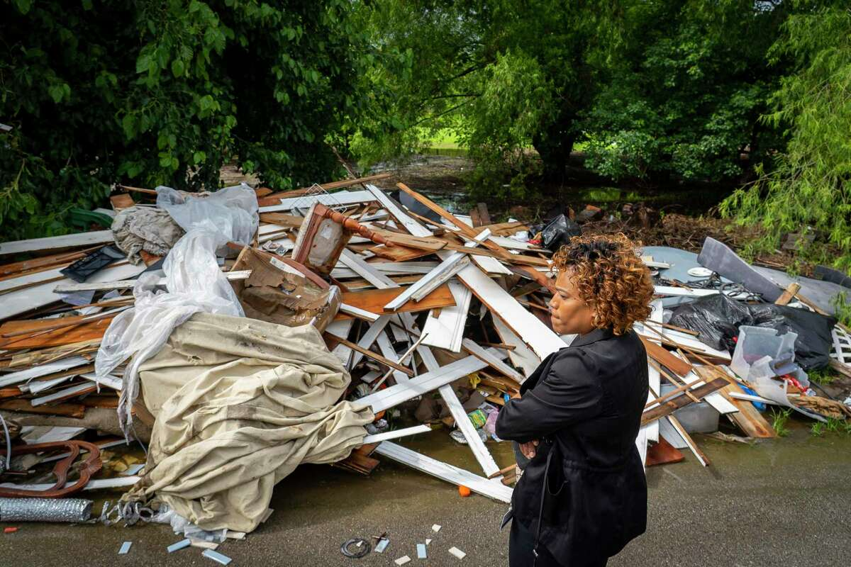 Councilmember Tarsha Jackson, who represents District B, looks at illegal dumping sites in Fifth Ward that she and her staff have been working to have cleaned up, Tuesday, May 25, 2021, in Houston.