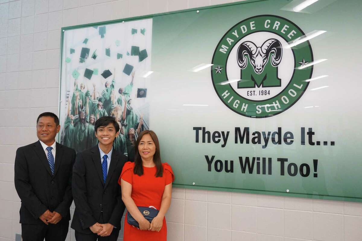 Min Ko Ko is the valedictorian of Mayde Creek High School in Katy and is set to attend Harvard University on a full-ride scholarship. Here, he poses with his father, Ko Ko Gyi, and mother, Khin Hla Hla.