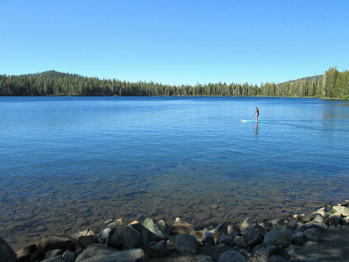 A stand-up paddleboarder on Gold Lake.