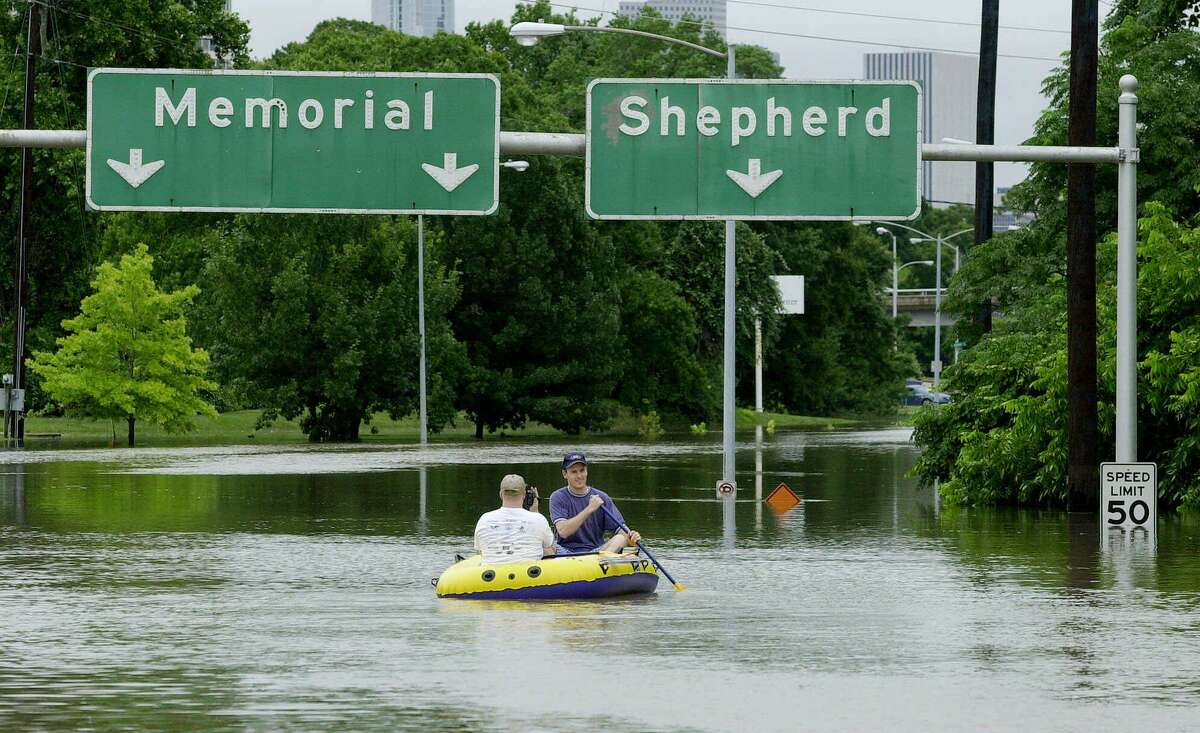 Hurricane Harvey wasn't the first major flooding disaster Houston endured, and it won't be the last. Here, Bryan Christiansen, right, and his cousin, Read Flake, paddle a rubber raft down Memorial Drive near downtown Houston on Saturday afternoon, June 9, 2001. Thousands of people were out of their homes and thousands more stranded on flooded freeways, their cars and trucks hopelessly under water, as torrential rains from the remnants of Tropical Storm Allison swamped Houston and Southeast Texas. (AP Photo/Eric Gay)