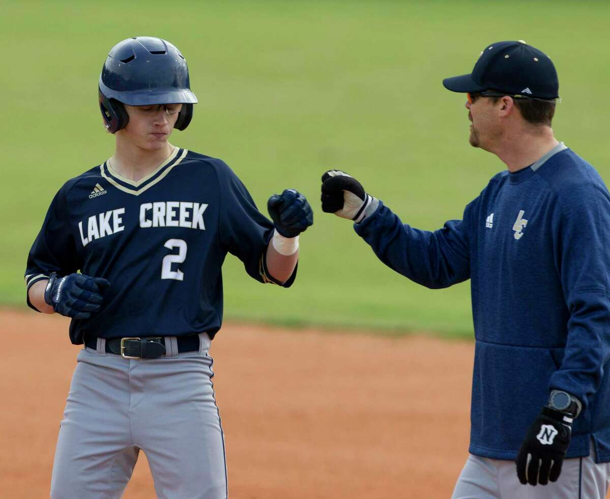 John Spikerman #2 of Lake Creek gets a fist-bump after hitting a single during the first inning of a District 20-5A high school baseball game at Caney Creek High School, Wednesday, March 6, 2019, in Grangerland.