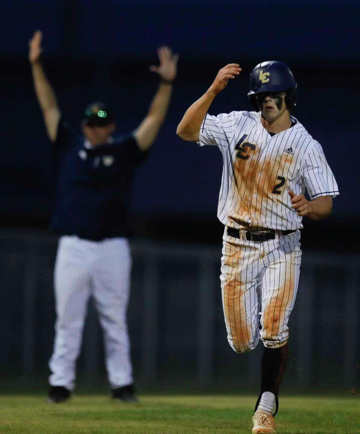 John Spikerman #2 of Lake Creek scores from second base after a thowing error during the fourth inning of a District 20-5A high school baseball game at Lake Creek High School, Tuesday, April 27, 2021, in Montgomery.