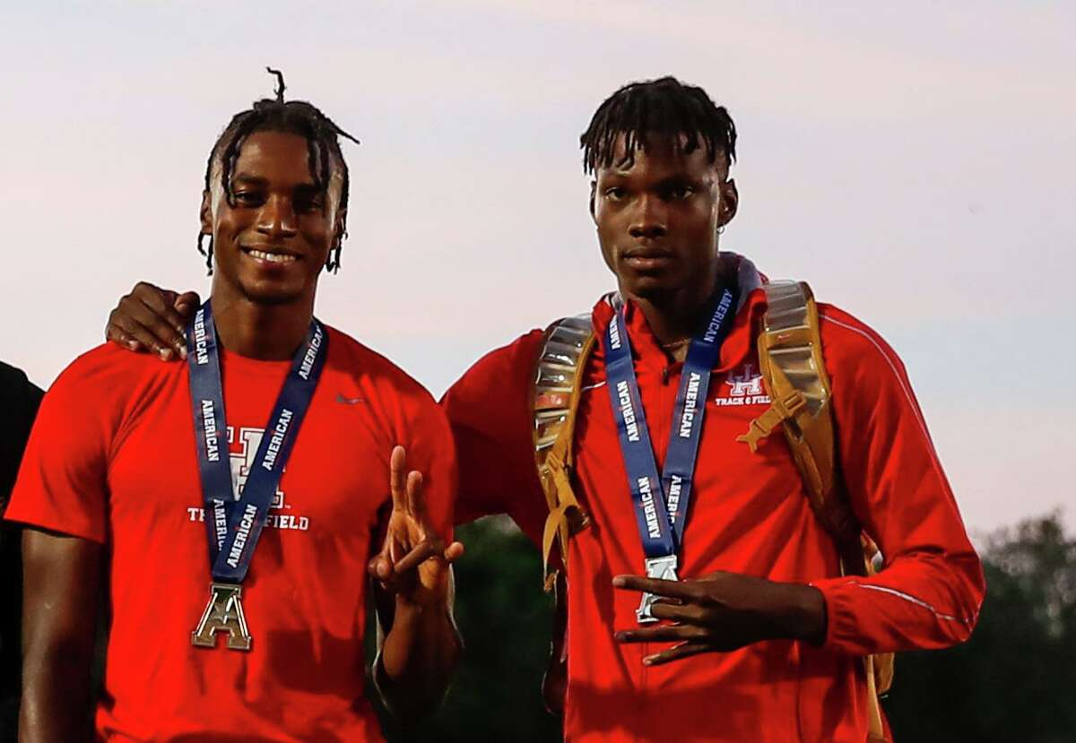 Brothers Dayo, left and DJ Akindele savor the podium at the 2021 American Athletic Conference outdoor meet after finishing first and second, respectively, in the 110 hurdles.