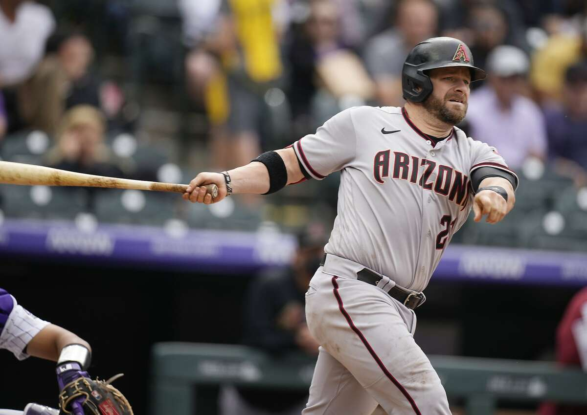 Arizona Diamondbacks' Stephen Vogt connects for a double off Colorado Rockies relief pitcher Mychal Givens in the seventh inning of a baseball game Saturday, May 22, 2021, in Denver. (AP Photo/David Zalubowski)