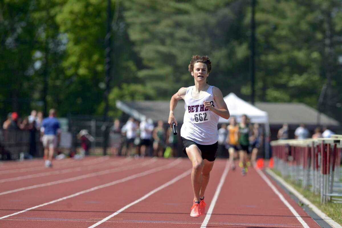 Bethel's Louis Marcantonio extends his lead on the last leg of the 4 x 800 meter relay at the SWC boys track and field championships, Tuesday afternoon, May 25, 2021, at Bethel High School, Bethel, Conn. Bethel took first place in the event.