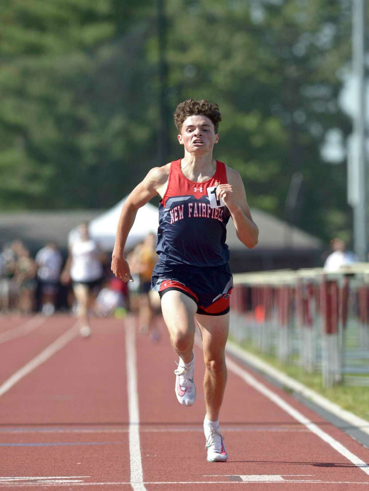 New Fairfield's Patrick Gibbons held on to his early lead to place first in the 1600 meter run at the SWC boys track and field championships, Tuesday afternoon, May 25, 2021, at Bethel High School, Bethel, Conn.