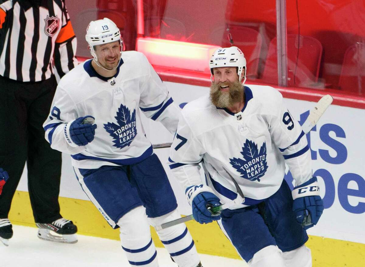 Toronto Maple Leafs' Joe Thornton, right, celebrates his gaol past Montreal Canadiens goaltender Carey Price with teammate Jason Spezza during the second period of Game 4 of an NHL hockey Stanley Cup first-round playoff series, Tuesday, May 25, 2021 in Montreal. (Paul Chiasson/The Canadian Press via AP)