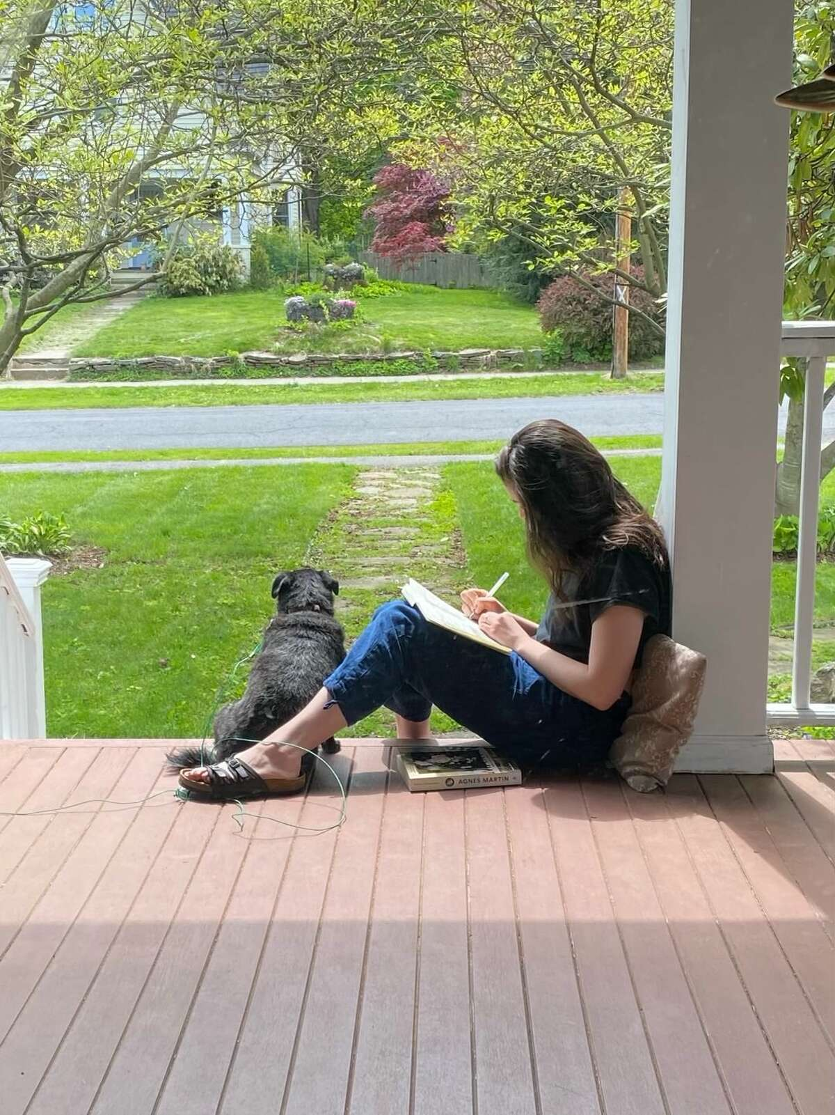 Two views of the porch on Donna Liquori and Mark McGuire's Delmar home.