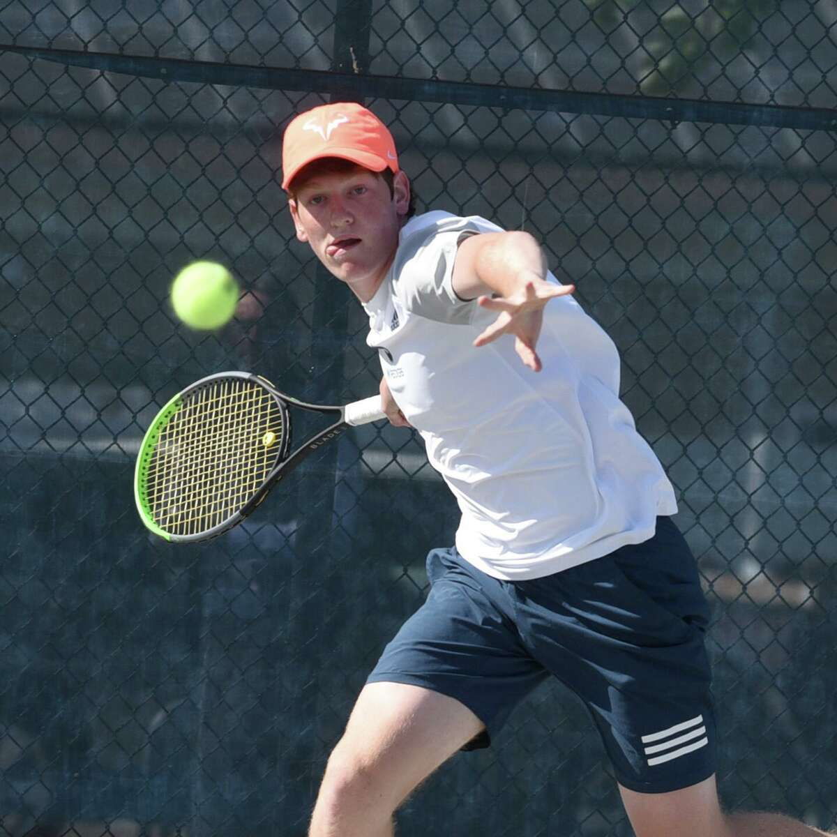 Staples' Tighe Brunetti lines up a shot against Darien's Chris Calderwood at No. 1 singles during the FCIAC tennis final Tuesday in Wilton.