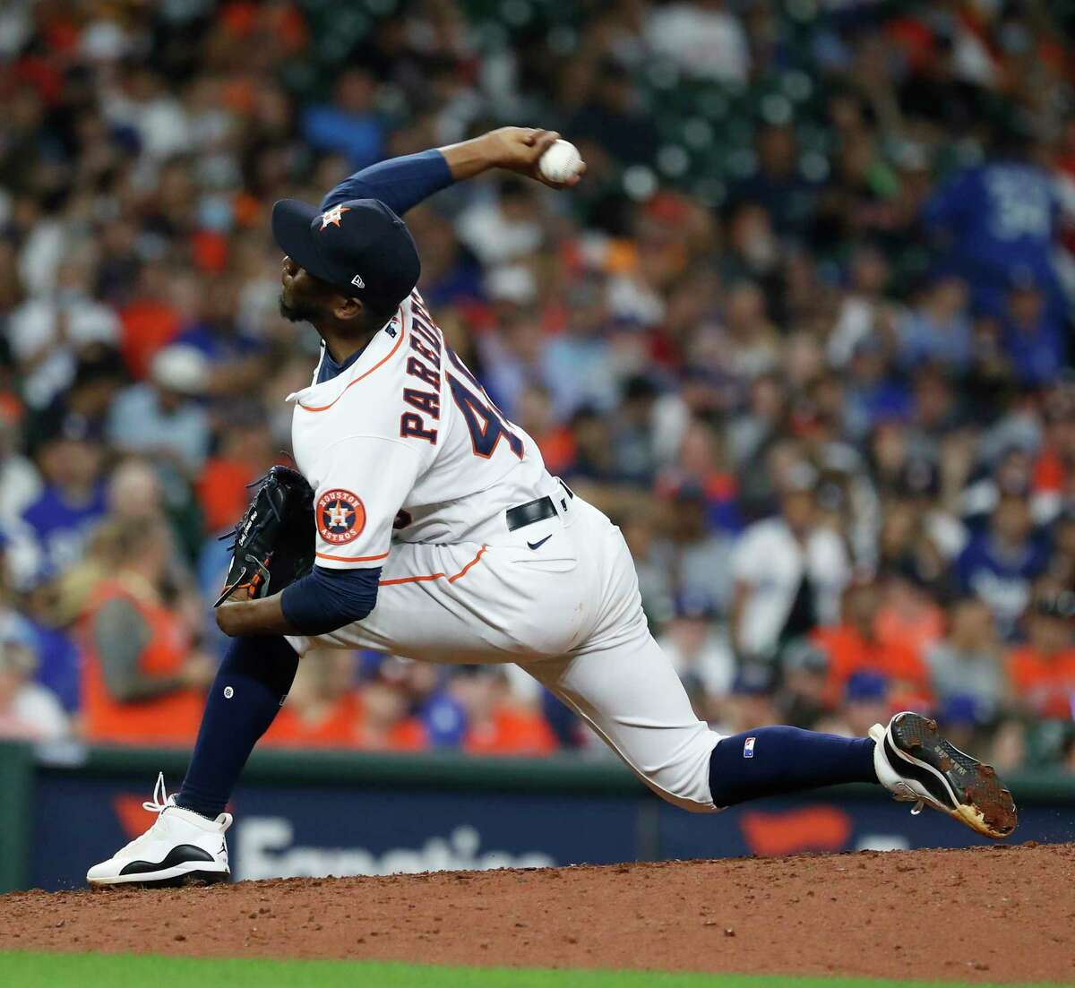 Houston Astros relief pitcher Enoli Paredes (48) throws to Los Angeles Dodgers Justin Turner during the seventh inning of an MLB baseball game at Minute Maid Park, Tuesday, May 25, 2021, in Houston.