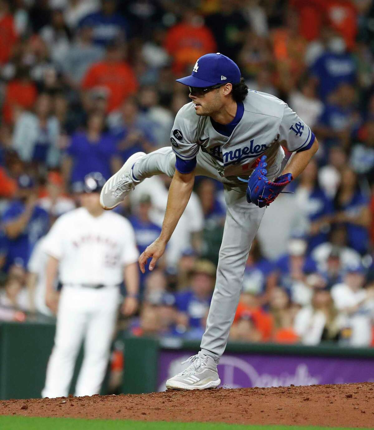 Los Angeles Dodgers relief pitcher Joe Kelly (17) pitches to Houston Astros Jose Altuve during the eighth inning of an MLB baseball game at Minute Maid Park, Tuesday, May 25, 2021, in Houston.