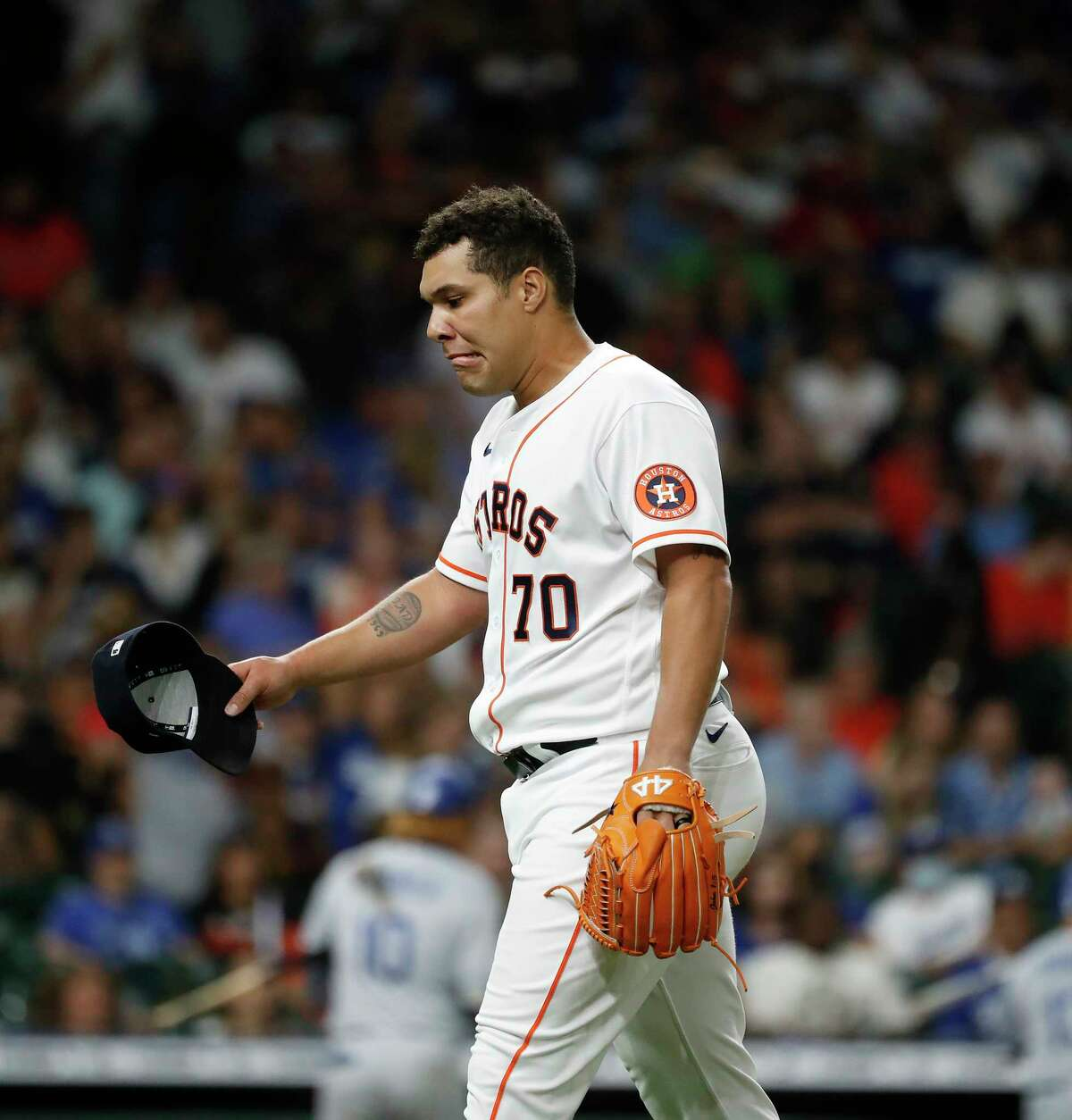 Houston Astros relief pitcher Andre Scrubb (70) reacts after issuing two walks with bases loaded during the eighth inning of an MLB baseball game at Minute Maid Park, Tuesday, May 25, 2021, in Houston.