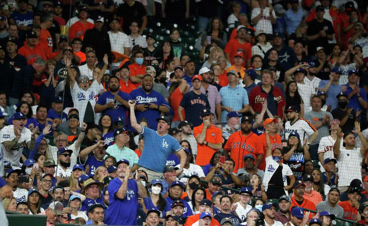 In an electric Minute Maid Park atmosphere, L.A. fans had more to cheer for than the home team Tuesday night as the Dodgers beat the Astros 9-2 for their eighth consecutive victory.