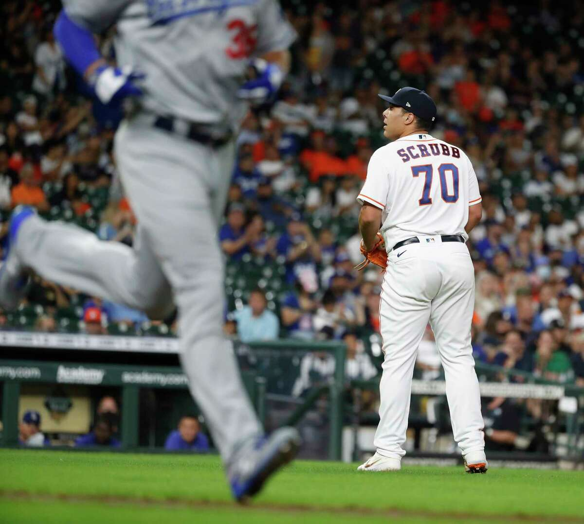 Houston Astros relief pitcher Andre Scrubb (70) reacts as he issued a walk to Los Angeles Dodgers DJ Peters to load the bases during the ninth inning of an MLB baseball game at Minute Maid Park, Tuesday, May 25, 2021, in Houston.