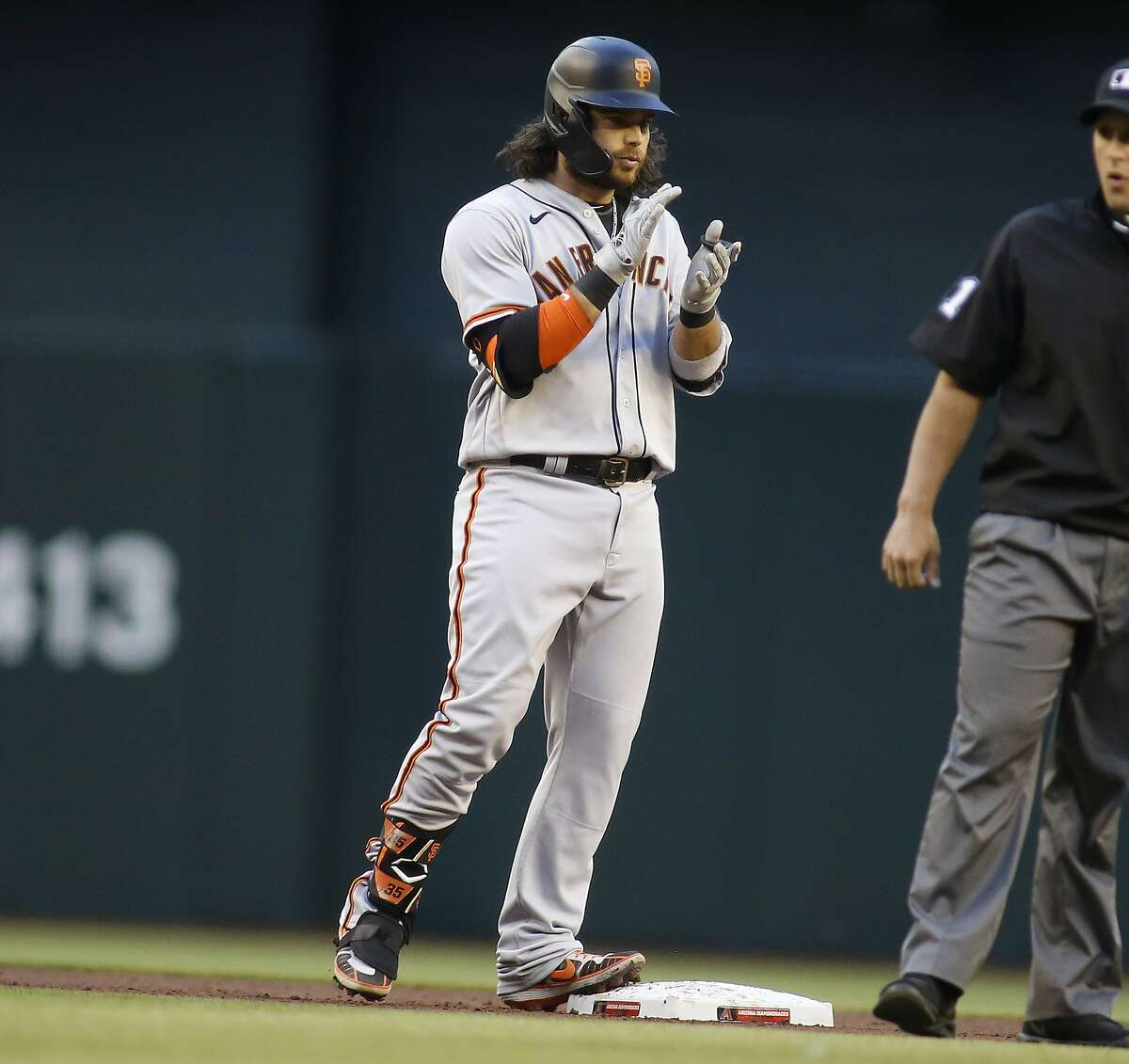 San Francisco Giants' Brandon Crawford's claps for himself after hitting a three-run double against the Arizona Diamondbacks during the first inning of a baseball game Monday, May 25, 2021, in Phoenix. (AP Photo/Darryl Webb)