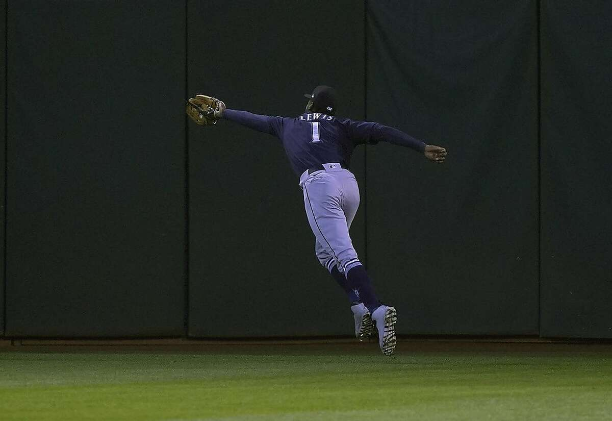 OAKLAND, CALIFORNIA - MAY 25: Kyle Lewis #1 of the Seattle Mariners makes a running catch taking a hit away from Ramon Laureano #22 of the Oakland Athletics in the fifth inning at RingCentral Coliseum on May 25, 2021 in Oakland, California. (Photo by Thearon W. Henderson/Getty Images)