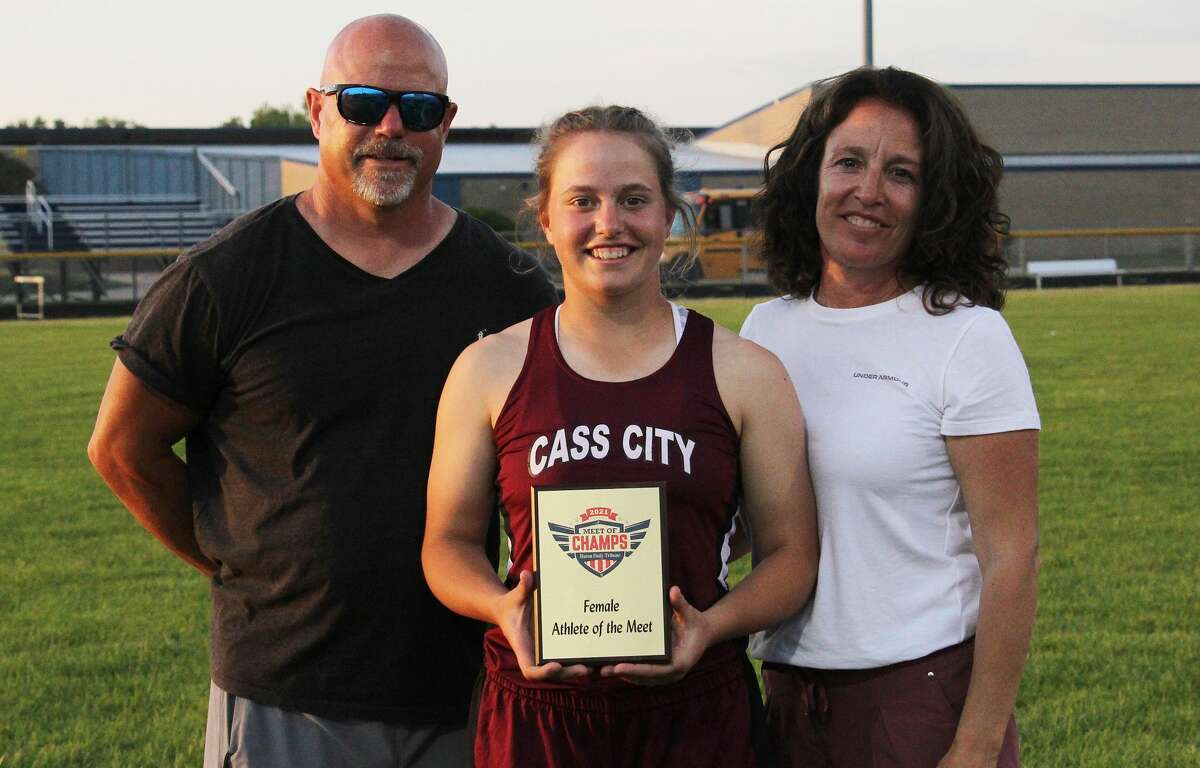 Cass City sophomore Saylar Cuthrell, seen with parents Scott and Amy Cuthrell, was named the Female Athlete of the Meet at Tuesday's Huron Daily Tribune Meet of Champs at Bad Axe High School.