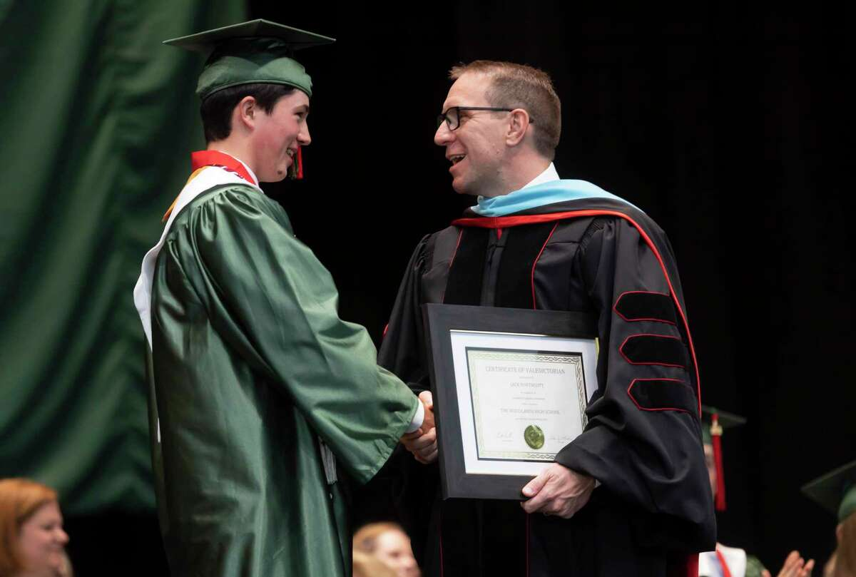 Conroe ISD Superintendent Curtis Null, right, shares a laugh with Class valedictorian Jack Andrew Northcott during The Woodlands High School's graduation ceremony at the Cynthia Woods Mitchell Pavilion, Tuesday, May 25, 2021, in The Woodlands.