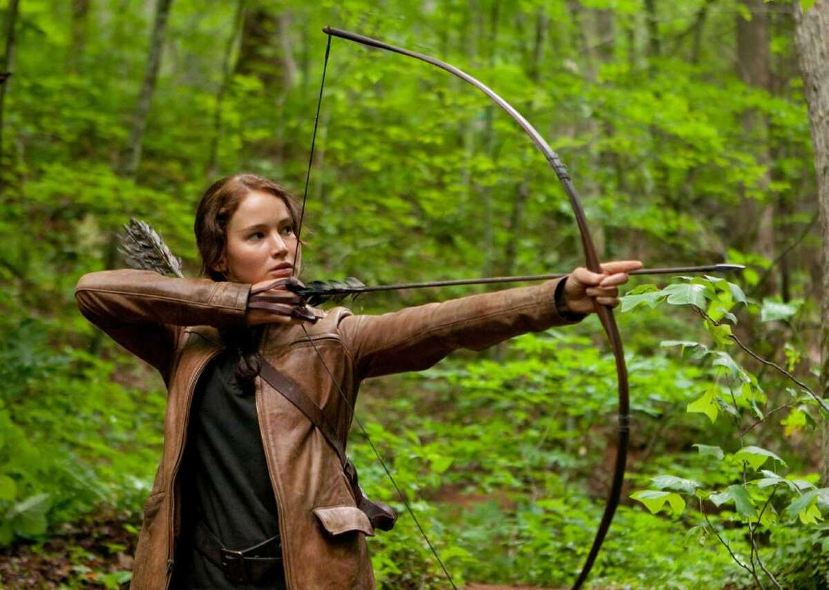 """#24. The Hunger Games (2012) - Director: Gary Ross - Stacker score: 81.4 - Metascore: 68 - IMDb user rating: 7.2 - Runtime: 142 minutes This dystopian film, based on the book series of the same name by Suzanne Collins, takes place in the fictional nation of Panem, where each year volunteers from 12 different districts must fight to the death. """"The Hunger Games"""" follows Katniss Everdeen (Jennifer Lawrence), a District 12 resident who takes her younger sister's place in the game and uses her archery skills to survive unthinkable tasks."""