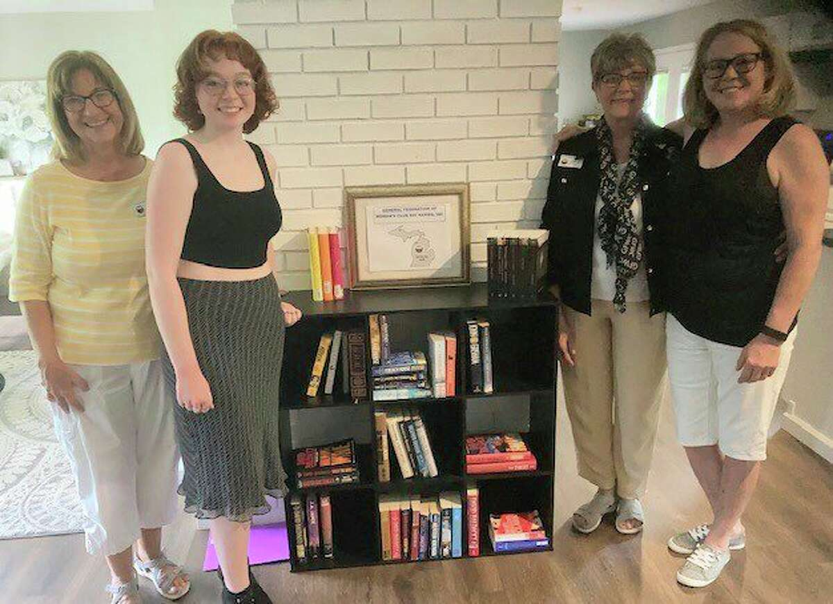 Pictured are GFWC member Celeste Szczerowski, Mary Antoncew, daughter, GFWC member Joyce Iltis and Casey Antoncew, mother and homeowner. (Courtesy photo)