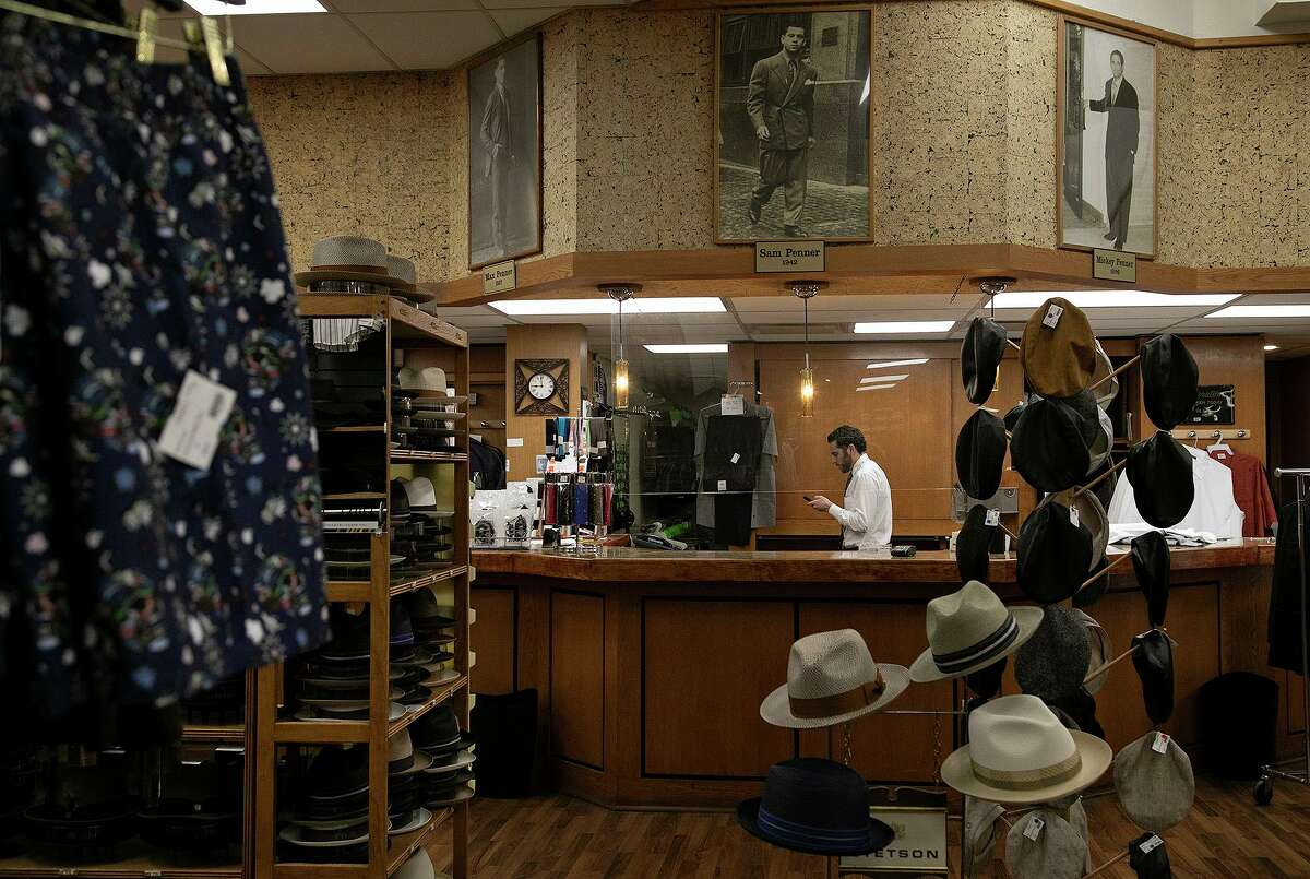 Max Penner, one of the owners of Penner's, works at the men's clothing store in downtown San Antonio on May 21, 2021.