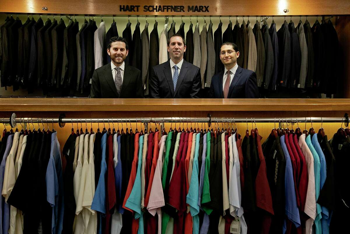 The owners of Penner's including Max Penner, left, his brother, Mitchell Penner, right, and their cousin, Matt Penner, center, at the men's clothing store in downtown San Antonio on May 21, 2021.