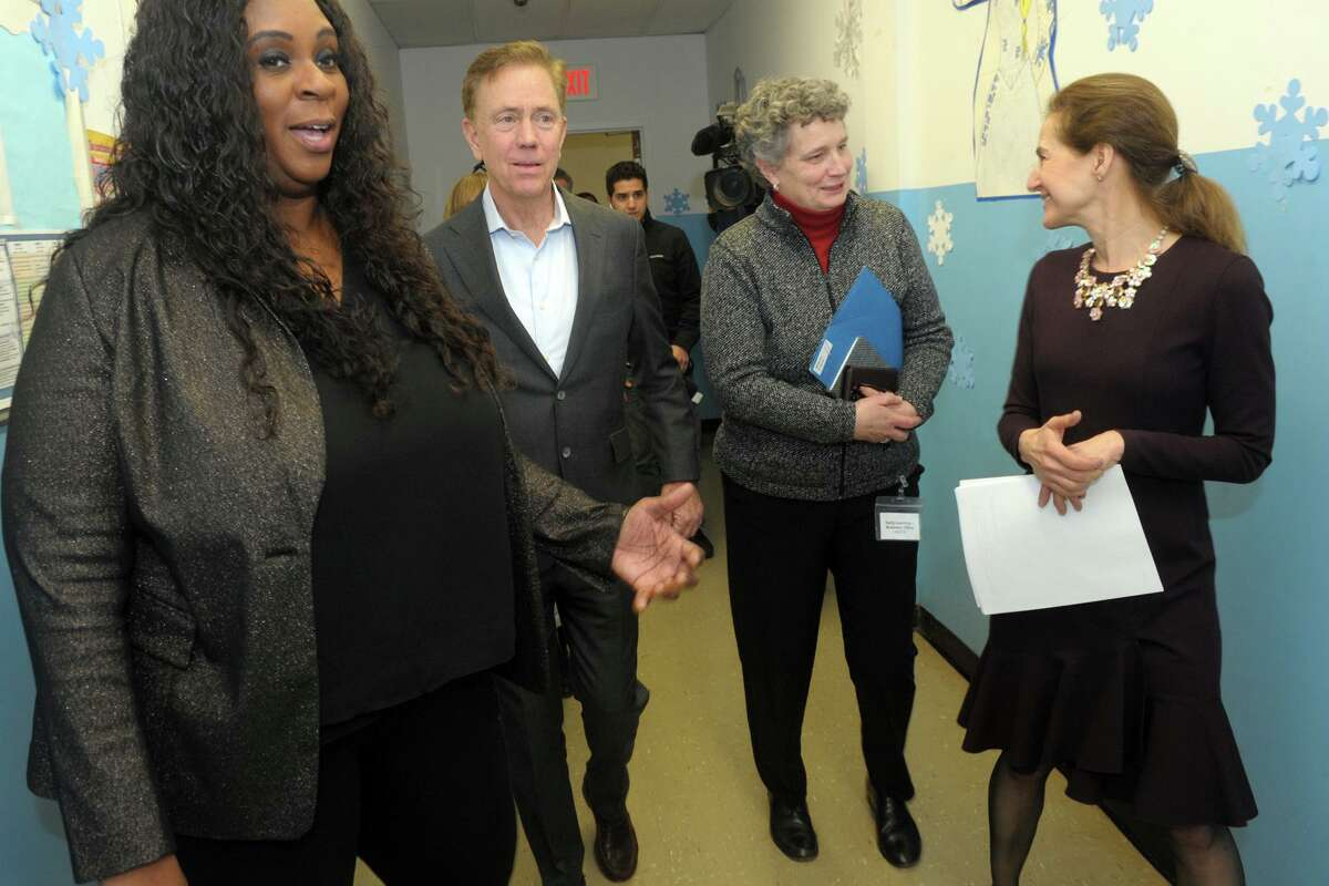 Monette Ferguson, left, leads a tour for Gov. Ned Lamont and Lt. Susan Bysiewicz in Bridgeport last year with state Office of Early Childhood Commissioner Beth Bye, third from left.