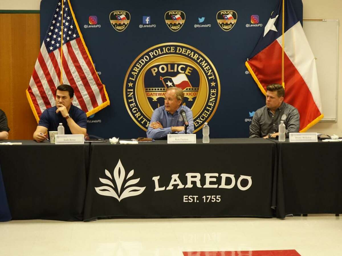 Texas Attorney General Ken Paxton, center, is pictured next to Deputy AG for Criminal Justice Josh Reno and First Assistant Attorney General Brent Webster on Tuesday at the Laredo Police Department.