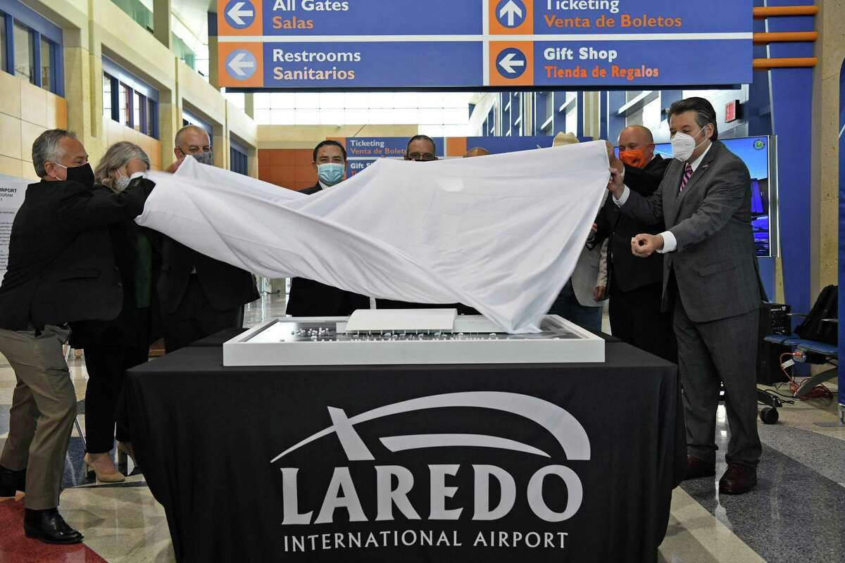 City officials and guests pull off the sheet to showcase the new preliminary expansion plans set for a tentative 2024 on Tuesday, May 25, 2021.