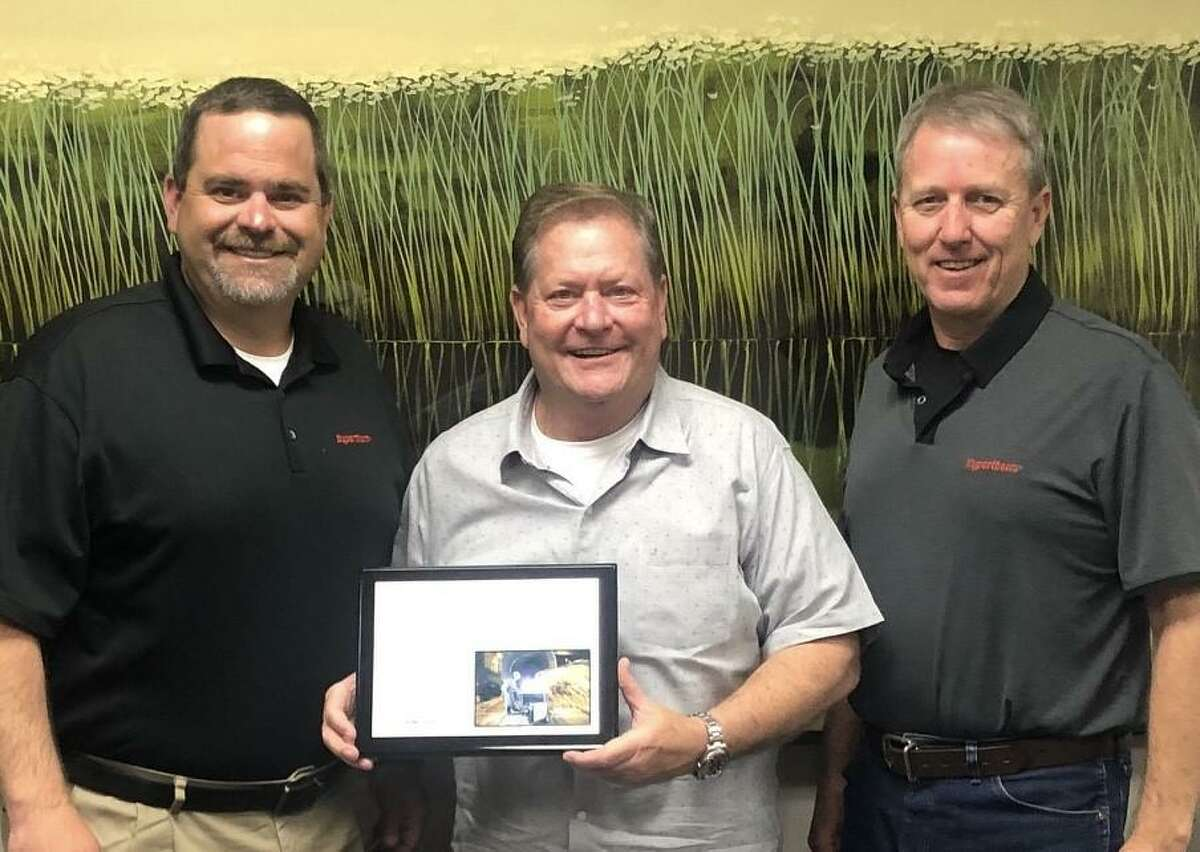 """J.C. """"Chuck"""" Mazoch, center, receives the Hypertherm Excellence In Distribution America's Award 2020 at his corporate office in Beaumont, April 2021. Presenting the honor were John Mark Hutchins (left) and David Sullins (right), Hypertherm Distribution Sales Managers."""