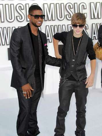 LOS ANGELES, CA - SEPTEMBER 12:  Singers Usher (L) and Justin Bieber arrive at the 2010 MTV Video Music Awards at NOKIA Theatre L.A. LIVE on September 12, 2010 in Los Angeles, California.  (Photo by Frederick M. Brown/Getty Images) *** Local Caption *** Usher;Justin Bieber Photo: Frederick M. Brown, Getty Images / 2010 Getty Images