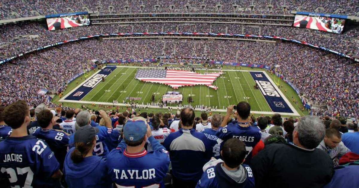 Military servicemen hold a United Sates flag on the field before an NFL football game between the New York Giants and the Carolina Panthers at New Meadowlands Stadium in East Rutherford, N.J., Sunday, Sept. 12, 2010.