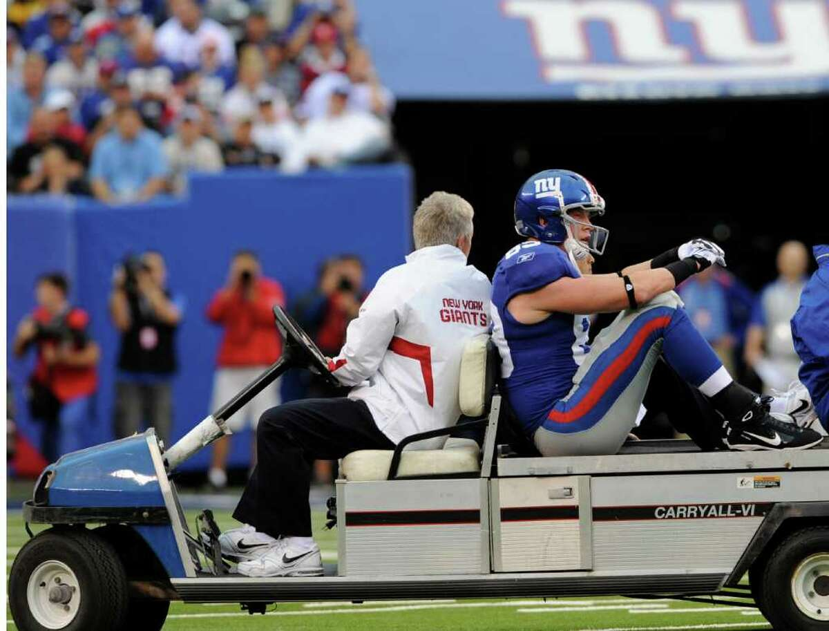 New York Giants' Kevin Boss, right, is taken off the field after being injured during the first quarter of an NFL football game against the Carolina Panthers at New Meadowlands Stadium in East Rutherford, N.J., Sunday, Sept. 12, 2010. Boss was hurt after being hit in the back of the neck by Panthers safety Sherrod Martin on the Giants' fourth play from scrimmage.