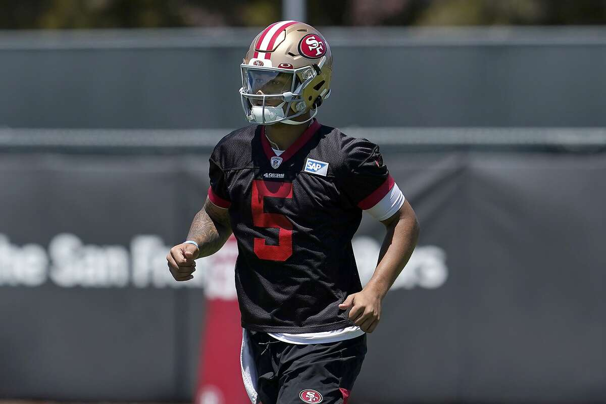 San Francisco 49ers quarterback Trey Lance jogs on the field at the team's NFL football training facility in Santa Clara, Calif., Tuesday, May 25, 2021. (AP Photo/Jeff Chiu)