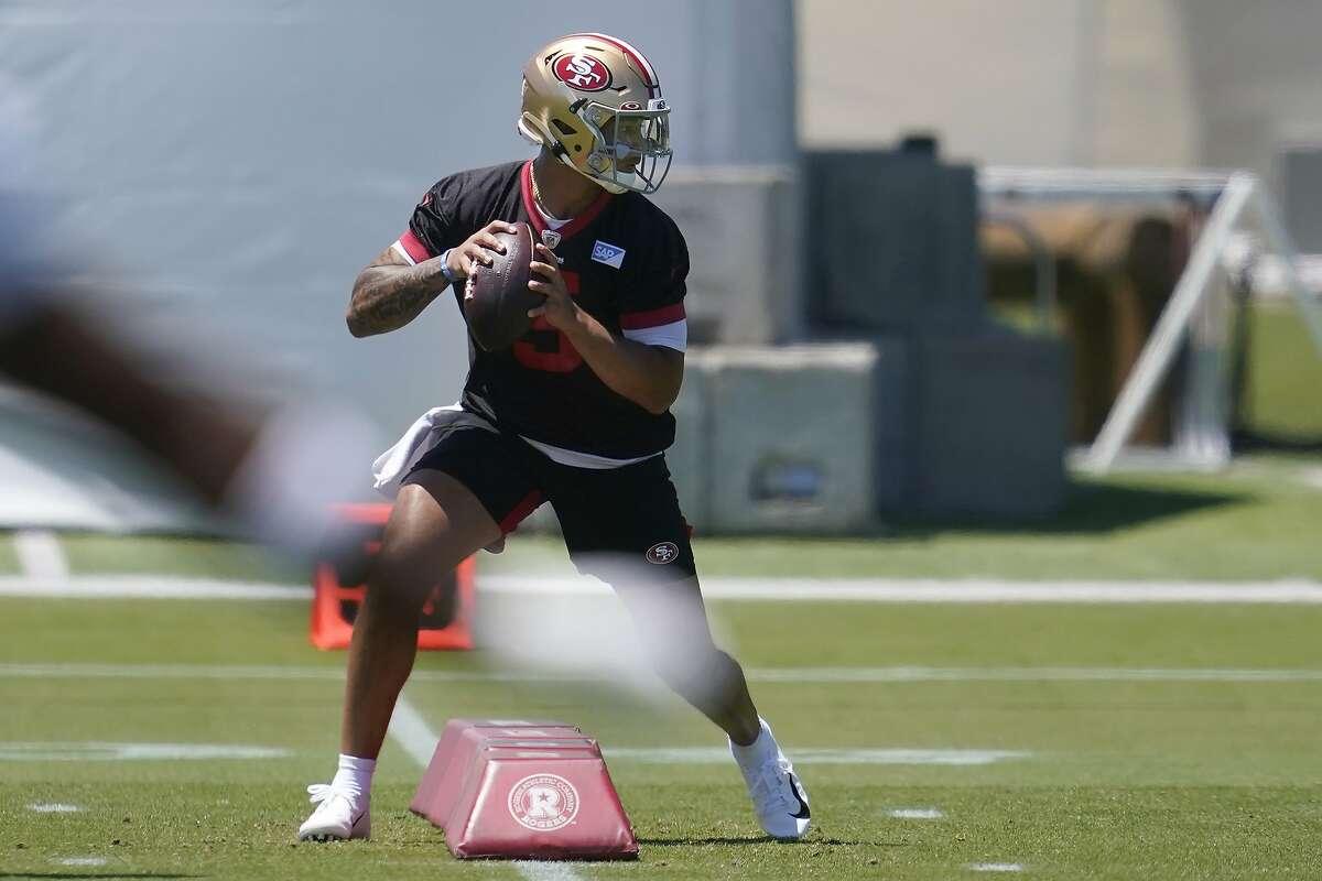San Francisco 49ers quarterback Trey Lance prepares to throw a pass at the team's NFL football training facility in Santa Clara, Calif., Tuesday, May 25, 2021. (AP Photo/Jeff Chiu)
