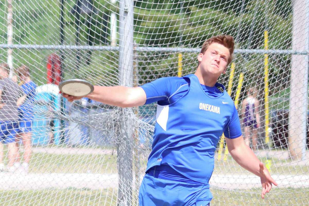 Ben Falk picks up a new personal best throw in the discus during his final high school track meet. (Robert Myers/News Advocate)