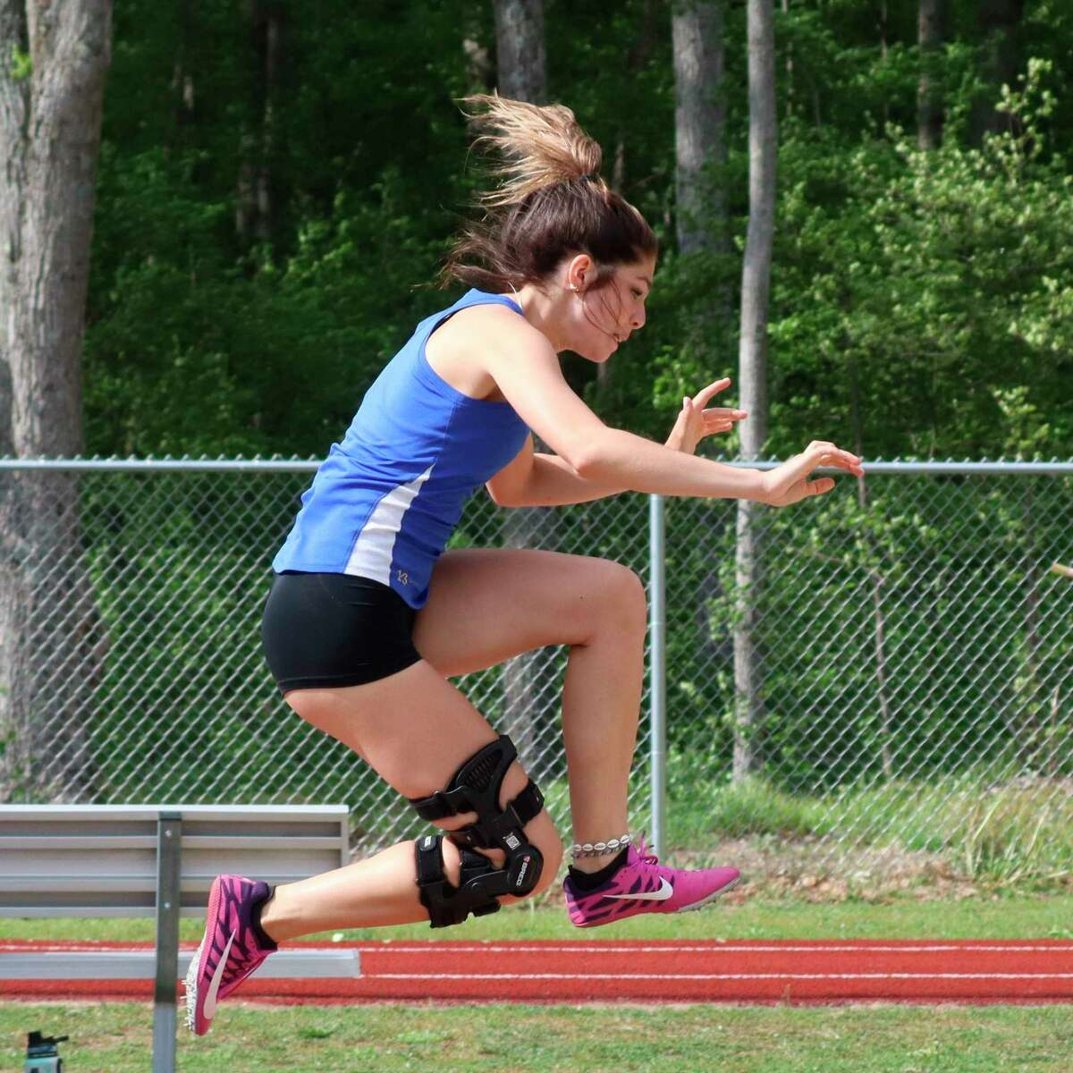 Sarah Bromley competes in the long jump during her final track meet for Onekama. (Robert Myers/News Advocate)
