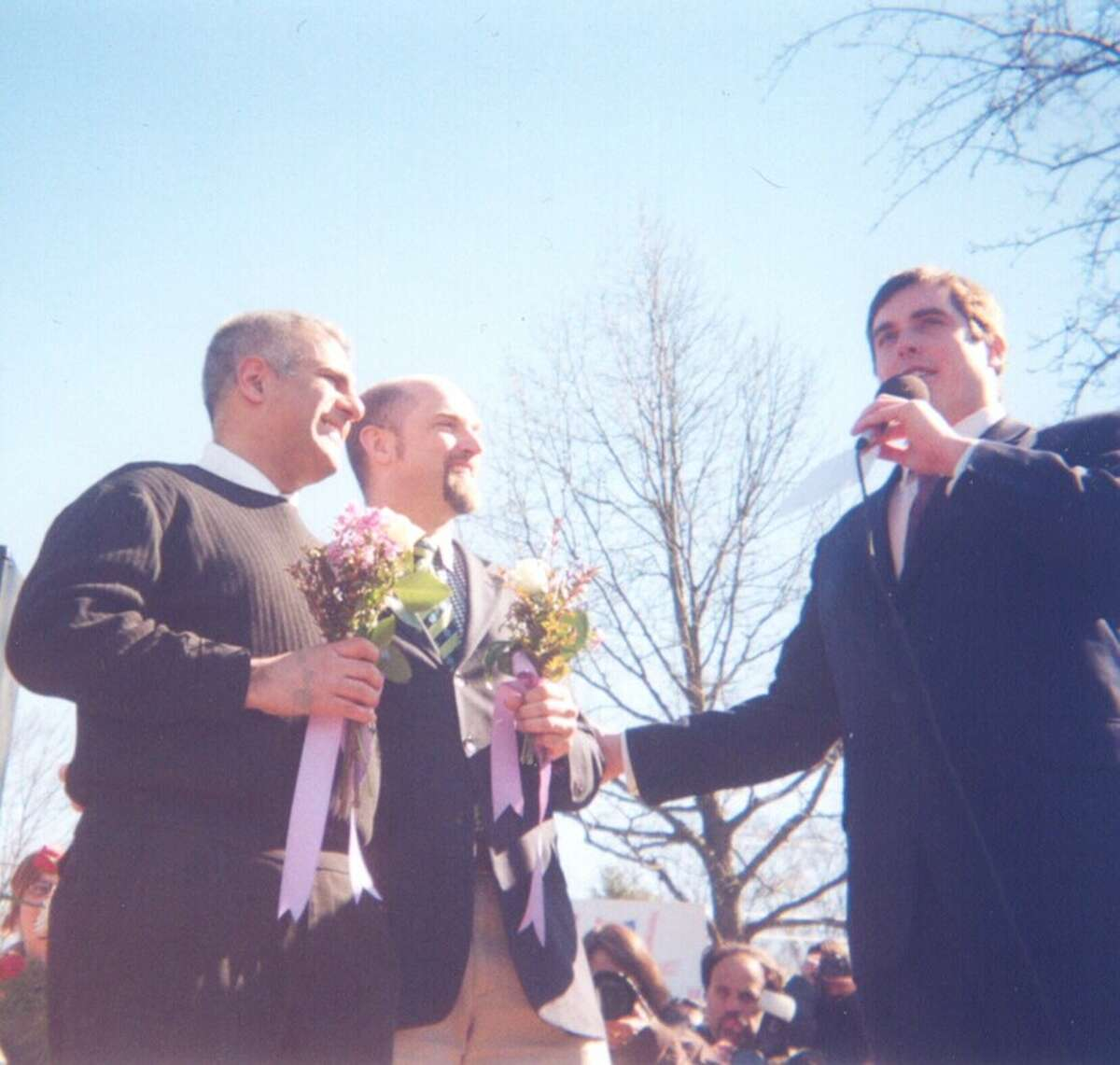 Jay Blotcher and Brook Garrett, left, were married at New Paltz's Peace Park in 2004 by the newly elected mayor, Jason West, right. That day, West married 25 same-sex couples - seven years before gay marriage was legal in the state.