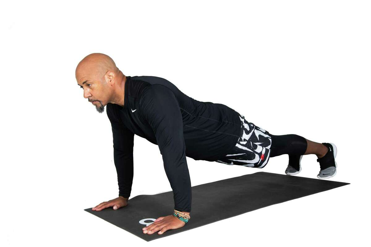 Start in a pushup-plank position with hands placed under shoulders.
